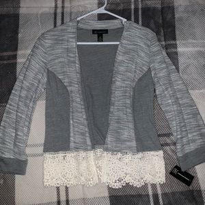 Adorable sweater with cute lace detail